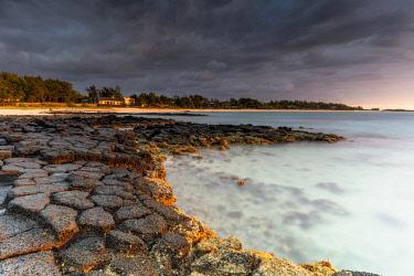CLKRM120787 Storm clouds at sunrise over Trou d'Eau Douce, Flacq district, Indian Ocean, East coast, Mauritius