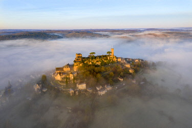 FRA11790AW An aerial view of the hilltop village of Turenne at sunrise, Correze, Limousin, Nouvelle-Aquitaine, France
