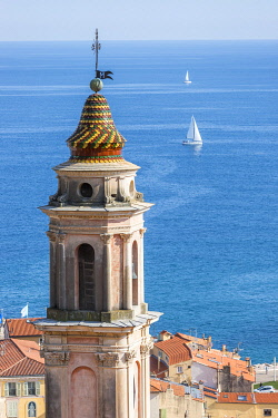 HMS3508558 France, Alpes-Maritimes, Menton, bell tower of the Immaculate Conception chapel, or White Penitents and the Bay of the Soleil