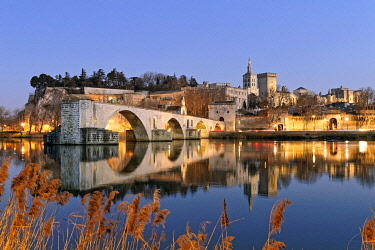 HMS3524789 France, Vaucluse, Avignon, Saint Benezet bridge on the Rhone dating from the 12th century with in the background Cathedral of Doms dating from the 12th century and the Papal Palace listed UNESCO World...