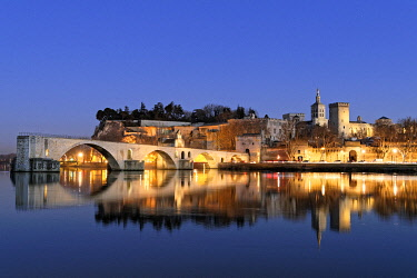 HMS3524791 France, Vaucluse, Avignon, Saint Benezet bridge on the Rhone dating from the 12th century with in the background Cathedral of Doms dating from the 12th century and the Papal Palace listed UNESCO World...