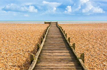 ENG16450AW A wooden walkway in Dungeness, one of the largest expanses of shingle in Europe, Kent, England