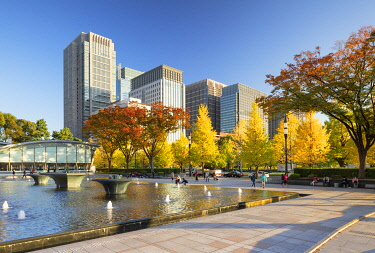 Skyscrapers of Marunouchi and Wadakura Fountain Park in the grounds of Imperial Palace, Tokyo, Japan