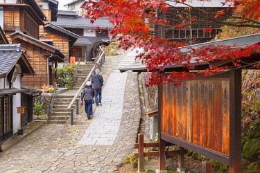 JAP2297AW People walking along Nakasendo Way passing through Magome, Gifu Prefecture, Japan