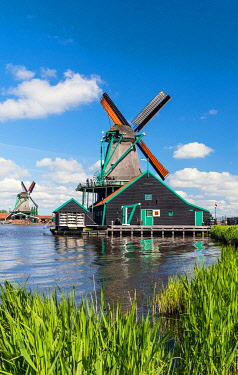 NLD1130AW Windmills in Zaanse Schans, an open air conservation area and museum near Amsterdam, the Netherlands