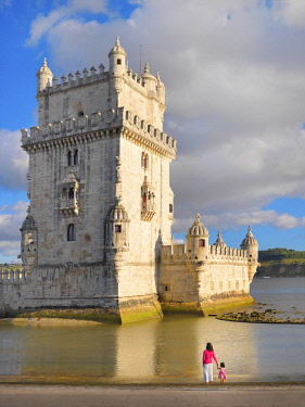 Portugal, Lisbon, Belem, Belem Tower, Woman and girl by lakeside (MR)