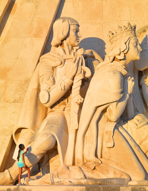 POR10781AW Portugal, Lisbon, Belem, Monument to the Discoveries (Padrao dos Descobrimentos), Girl looking at monument. (MR)