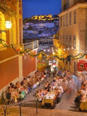 POR10791AW Portugal, Lisbon, Calcada do Duque, restaurant with a view of Sao Jorge castle at dusk