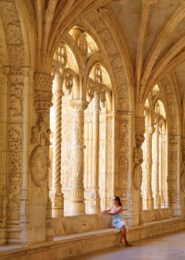 POR10792AW Portugal, Lisbon, Jeronimos Monastery, UNESCO World Heritage Site, Woman sitting by window( MR)