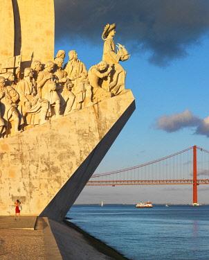 POR10793AW Portugal, Lisbon, Belem, Monument to the Discoveries, (Padrao dos Descobrimentos), Woman admiring monument. (MR)