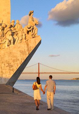 POR10794AW Portugal, Lisbon, Belem, Monument to the Discoveries (Padrao dos Descobrimentos), Man and woman walking (MR)