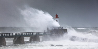 HMS3530892 France, Vendee, Les Sables d'Olonne, harbour channel lighthouse in Miguel storm