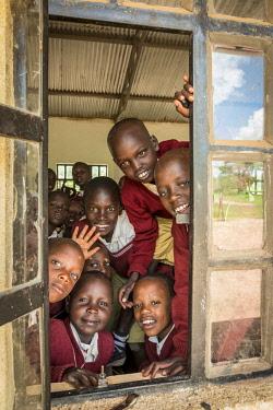 TZ4148AW Africa, Tanzania, Loiborsoit. Smiling school kids.