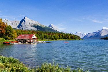 CAN3523AWRF Maligne Lake Boat House with canoa and blue sky, Jasper National Park, Alberta, Canada