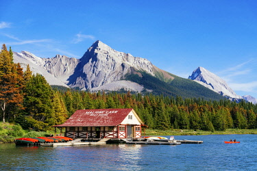 CAN3524AWRF Maligne Lake Boat House with canoa and blue sky, Jasper National Park, Alberta, Canada