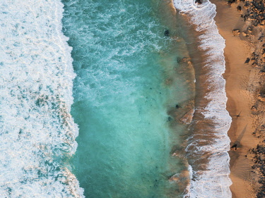 SPA9700AW Playa del Aguila, El Cotillo, Fuerteventura. Aerial view directly above waves. Canary Islands