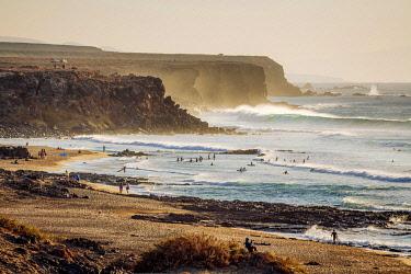 SPA9702AW Surfers in El Cotillo coastline, Fuerteventura, Canary Islands. Spain