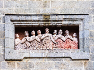 SPA9631 Spain. Galicia. Santiago de Compostela. A Roman Catholic high relief showing penitents in purgotary to purify their souls before their transition to heaven. Roman Catholic iconography is present all o...
