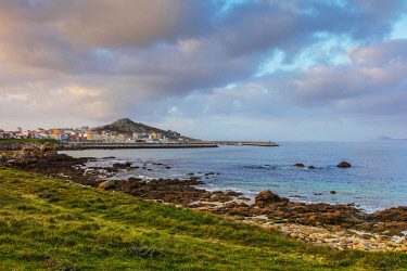 SPA9648 Spain. Galicia. Muxia. The town o Muxia as seen from the ocean on the path of the Camino which pilgrims see on their way to Muxia and Finisterre after they finish their destination in Santiago.