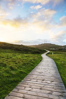 SPA9649 Spain. Galicia. Muxia. A wooden path on the ocean on the Camino way to Muxia leading to the town of Muxia one of the main destinations apart for Finisterre for pilgris on the Camino after they finish...