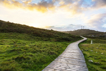 SPA9650 Spain. Galicia. Muxia. A wooden path on the ocean on the Camino way to Muxia leading to the town of Muxia one of the main destinations apart for Finisterre for pilgris on the Camino after they finish...