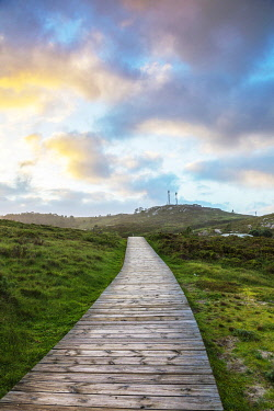 SPA9651 Spain. Galicia. Muxia. A wooden path on the ocean on the Camino way to Muxia leading to the town of Muxia one of the main destinations apart for Finisterre for pilgris on the Camino after they finish...