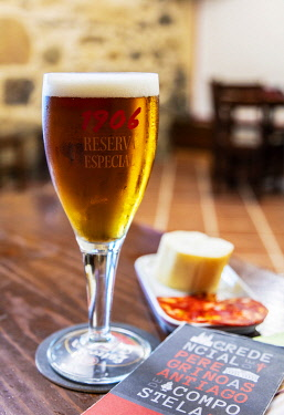 SPA9664 Spain. Galicia. Mos. Spanish beer and pincho or tapa and the pilgrim s credencial in Portugese typical stops at bars on the Camino Portuges towards Santiao de Compostela.