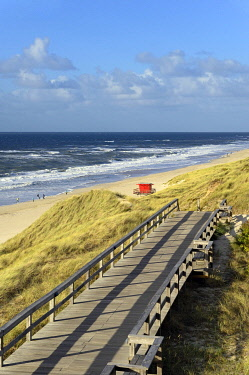 IBXRBA05088088 Boarded footpath leads through the dunes, red rescue tower on the beach, Wenningstedt, Sylt, North Frisian Island, North Sea, North Frisia, Schleswig-Holstein, Germany, Europe