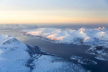 IBXSTA04902699 Aerial view, snow-covered mountains with fjord, province Tromso, Tromso, Norway