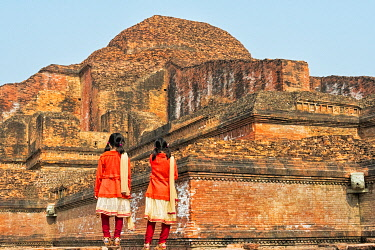 AS03KSU0037 Girl students in uniform at Somapura Mahavihara (Paharpur Buddhist Bihar), UNESCO World Heritage Site, Paharpur, Naogaon District, Rajshahi Division, Bangladesh