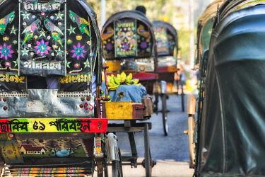 AS03KSU0099 Colorful painted rickshaw on the street, Chittagong Division, Bangladesh