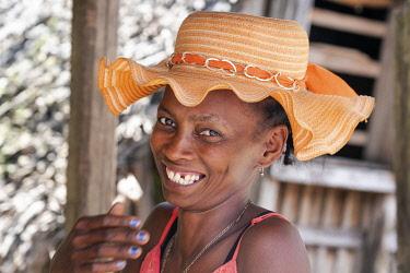 AF24EGO0343 Africa, Madagascar, near Andesite, Alaotra-Mangoro Region. Portrait of a Malagasy woman in her orange hat.