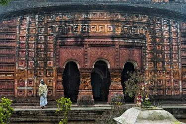 AS03KSU0224 Man at the Pancharatna Gobinda Temple, part of Puthia Temple Complex, Rajshahi Division, Bangladesh.