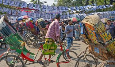 AS03KSU0246 Rickshaws and election banners on the street, Dhaka, Bangladesh.