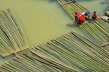 AS03KSU0275 Transporting bamboo timber on the river, Chittagong, Bangladesh.