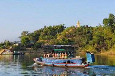 AS03KSU0285 Boats on Kaptai Lake and a Buddhist statue on the bank, Rangamati, Chittagong Division, Bangladesh.