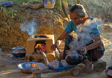 AS03KSU0287 Woman preparing tea in Chakma tribal village, Rangamati, Chittagong Division, Bangladesh.