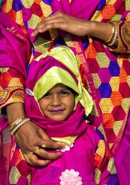 AS03KSU0298 Woman and girl in colorful dress, Bandarban, Chittagong Division, Bangladesh.