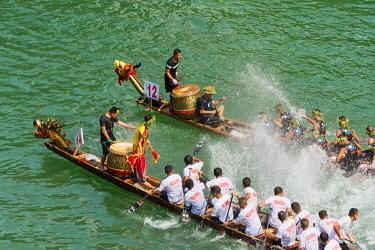 AS07KSU2706 Dragon Boat race on Wuyang River during Duanwu Festival, Zhenyuan, Guizhou Province, China.