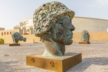 AS30EWI0065 Qatar, Doha. Katara Cultural Center, Subodh Gupta's Three Monkeys Sculpture, made from bronze, steel and old utensils. Portrayed in military helmet, terrorist hood and gasmask