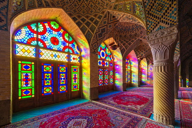 IBLGAB05100189 Nasir-ol-Molk Mosque, Light patterns from colored stained glass illuminating the iwan, Shiraz, Fars Province, Iran, Asia