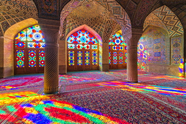 IBLGAB05100190 Nasir-ol-Molk Mosque, Light patterns from colored stained glass illuminating the iwan, Shiraz, Fars Province, Iran, Asia