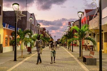 IBLYUC05091298 Pedestrian zone with poinsettia in the evening, Santa Maria, Sal Island, Cape Verde, Africa