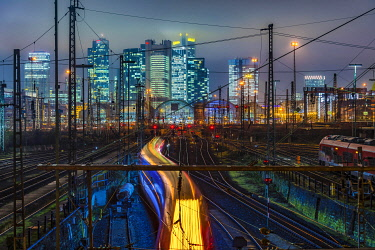 IBXCAG05109449 Driving train in front of Frankfurt am Main central station in front of the skyline, colorfully illuminated, Frankfurt, Hesse, Germany, Europe