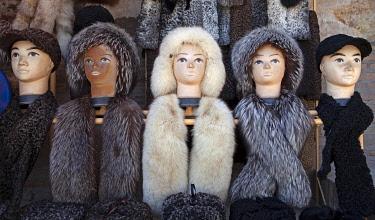 IBXCXB05088748 Mannequins with fur caps, bazaar, old town of Khiva, Xorazm province, Uzbekistan, Asia