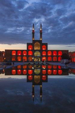 IBXGAB05100231 Amir Chaqmaq complex facade illuminated at sunrise and reflecting in a pond, Yzad, Yazd province, Iran, Asia