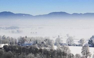 IBXHLI04504620 Morning fog in winter over Loisachtal, village of Zell, Upper Bavaria, Bavaria, Germany, Europe
