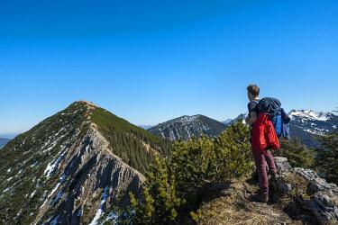 IBXMAB04539913 Hiker on ridge, hiking trail to Brecherspitz, Schliersee, Oberbayern, Bavaria, Germany, Europe