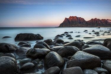 IBXROH04512228 Rocks on the beach of Uttakleiv, evening mood Vestvagay, Lofoten, Norway, Europe