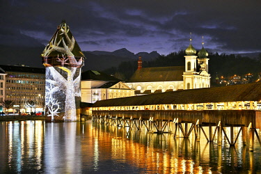 IBXSHU05099781 Wassertum with light installation, right Chapel Bridge, behind Jesuit Church on the Reuss at dusk, Old Town, Lilu, Light Festival 2020, Lucerne, Canton Lucerne, Switzerland, Europe